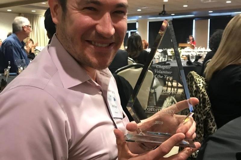 Image of Justin Bayer receiving award